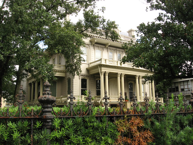 Garden District mansion in New Orleans framed by trees